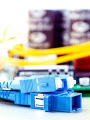Closeup of fiber optic connector with Circuits board