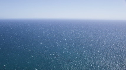 Aerial helicopter view of perfect blue Ocean