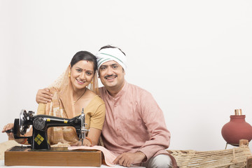indian couple with swing machine portrait
