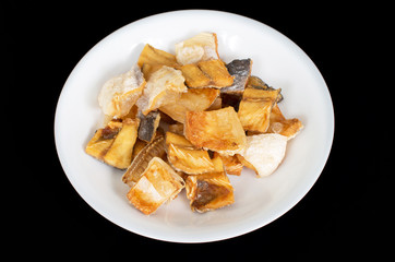 Vietnamese  deep fried dried Pangasius kunyit fish, ca dua kho c
