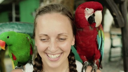 Girl with two parrot on his shoulder