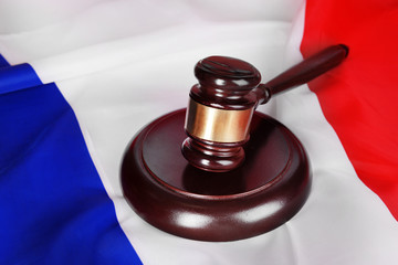 Wooden gavel on French flag background