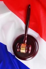 Wooden gavel on French flag background