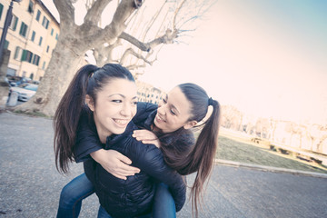 Female Twins Playing together and Enjoy Getting Piggyback Ride