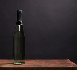 White wine bottle on black background