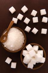 Sugar and Sugar Cube on Wood Background