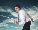 Determined businessman running in the sky poster
