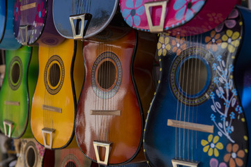 Row of Colorful Guitars on Display