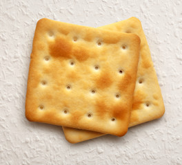Two dry cracker cookies