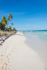 Young Girl Walking beaches of Tulum. Caribbean Paradise,