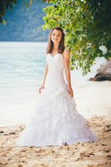 brunette bride in white elegant dress