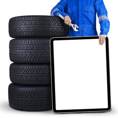 Mechanic with billboard and tires