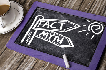 fact and myth signpost hand drawing on blackboard