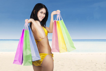 Sexy woman holding shopping bags