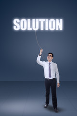 Smart businessman pulling a solution text