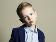 funny little boy.stylish child in suit
