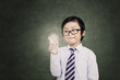 Young asian boy holds a light bulb