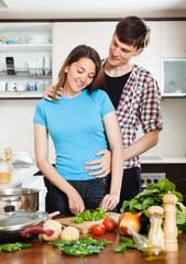 man flirting with pretty girl in  kitchen