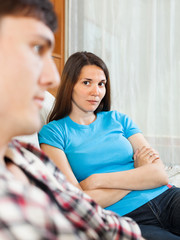 Unhappy woman having conflict with husband