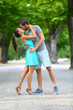 Young couple lovers in love kissing in summer park
