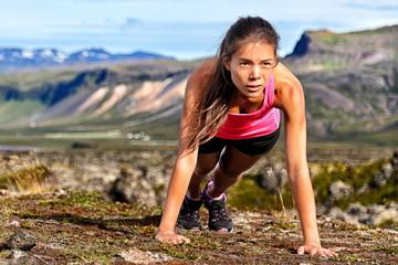 Fitness push-ups woman doing pushups outdoors