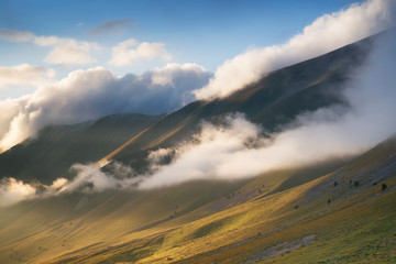 Cloudscape in mountain valley. Beautiful natural landscape