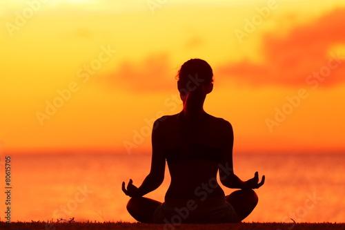 Wellness woman doing zen yoga meditation on beach - 80615705