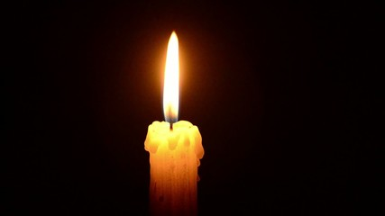 Candle and wind, blinking flame