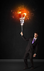 Businessman with an explosion bulb