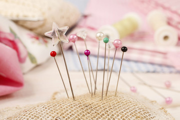 Pin cushion with sewing pins