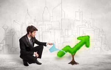 Business man watering green plant arrow