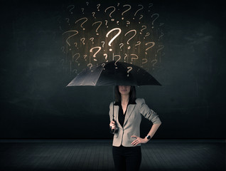 Businesswoman with umbrella and a lot of drawn question marks