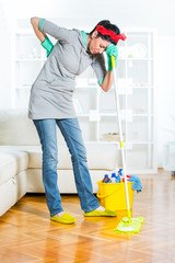 Woman was aching back while cleaning the floor