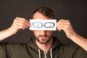 Happy guy looking with paper hand drawn eye glasses