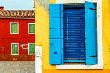 Colorful window of a house on the Venetian island of Burano