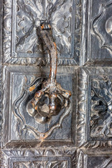 old wrought iron door with beautiful patterns