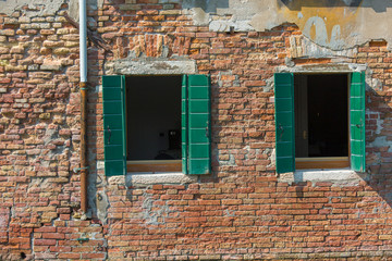 Beautiful venetian windows of a typical Venetian house, Italy