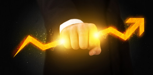 Business person holding a hot glowing upright arrow
