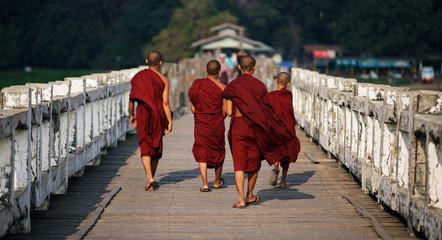 Unrecognized Buddhist monks walking on U Bein Bridge