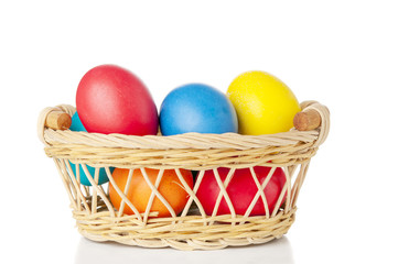 Easter eggs in basket on white background