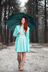 Cute red-haired girl in   park
