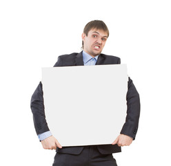 looking smiling business man showing blank signboard