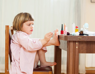 Little girl paints her nails