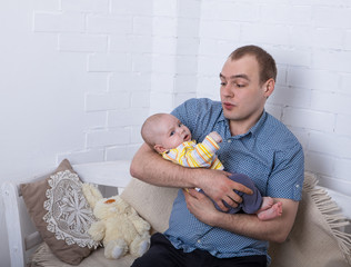 Dad and baby at home