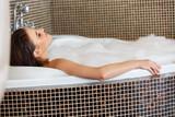 Woman Relaxing in Bubble Bath. Body Care