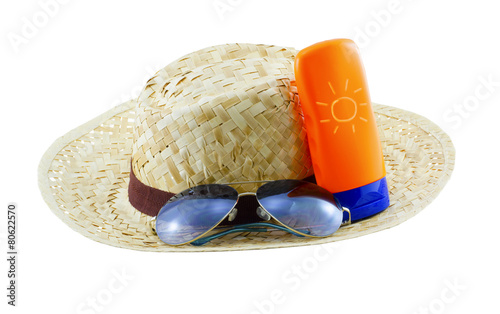 Hat with sunglasses and body lotion isolated on white background