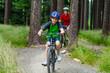 Healthy lifestyle - teenage girl and boy biking