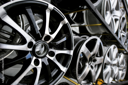 canvas print picture Car wheels on a shelf in the store