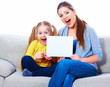 Mother with daughter show white blank board.