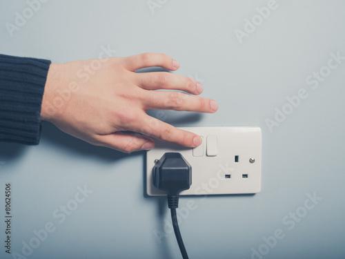 Leinwandbild Motiv Male hand pushing switch